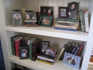 Framed photos in various sizes offer a nice contrast to old books