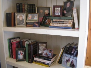 By simply elevating the books at the left of the top shelf, makes the display more interesting.
