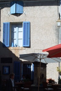 Blue shutters and umbrella