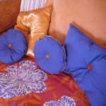 Pillows in a variety of shapes and sizes make the bed more interesting.