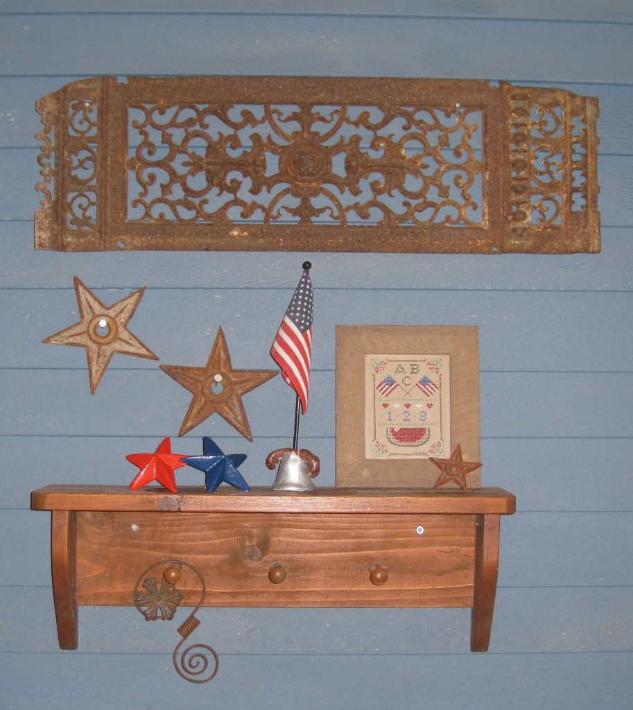 Create a wall collage with your vintage iron work by adding old architechturall stars.