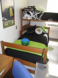 Lofted or bunk beds free up the floor.  Talk to your room mate about color choices and who will bring the important stuff like the TV, refrigerator and chairs!
