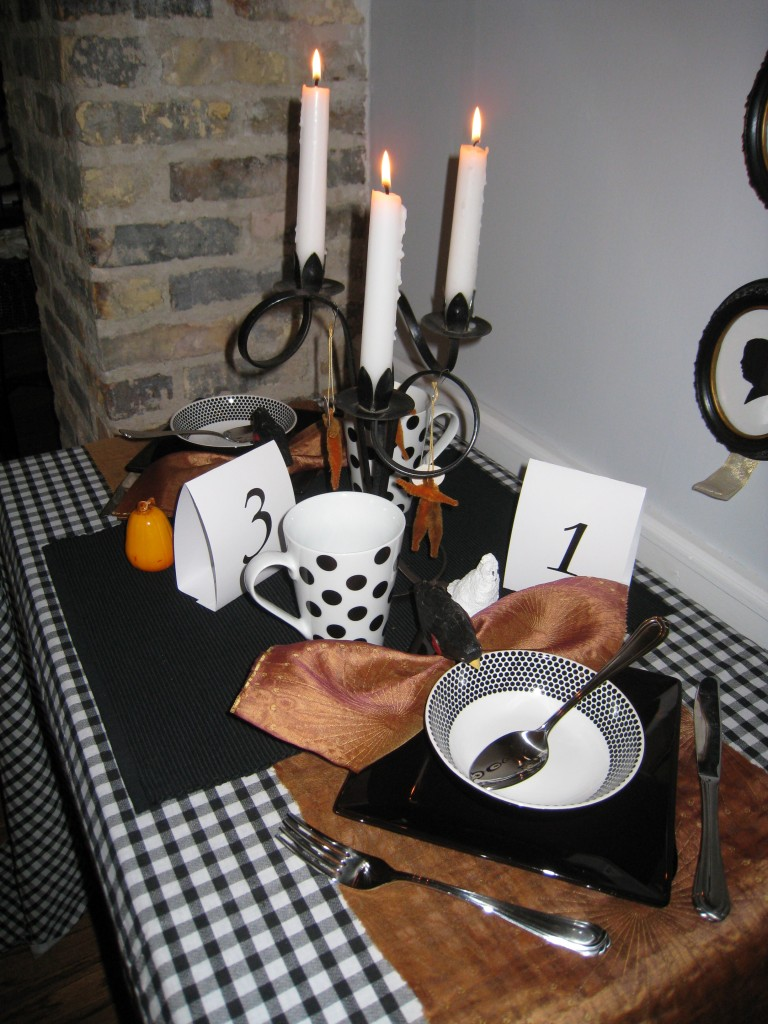 Pile on the layers and add texture for a cozy Halloween lunch table