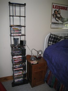The tall DVD shelf is new (and almost full) and the bedside table is part of an old bachelor's dresser.