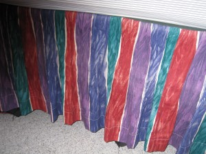 Imade this bedskirt several years ago.  It's still in great shape and has red in it.  Maybe it will still work.