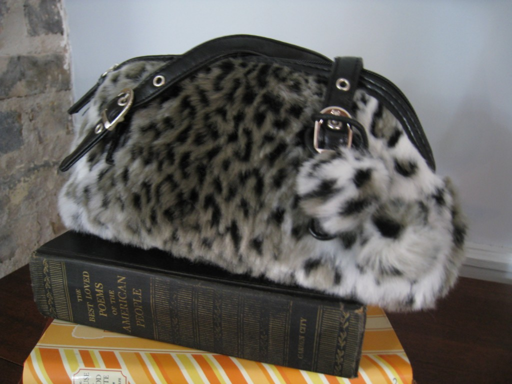 Funky fake leopard small bag with pom poms.  $12.00