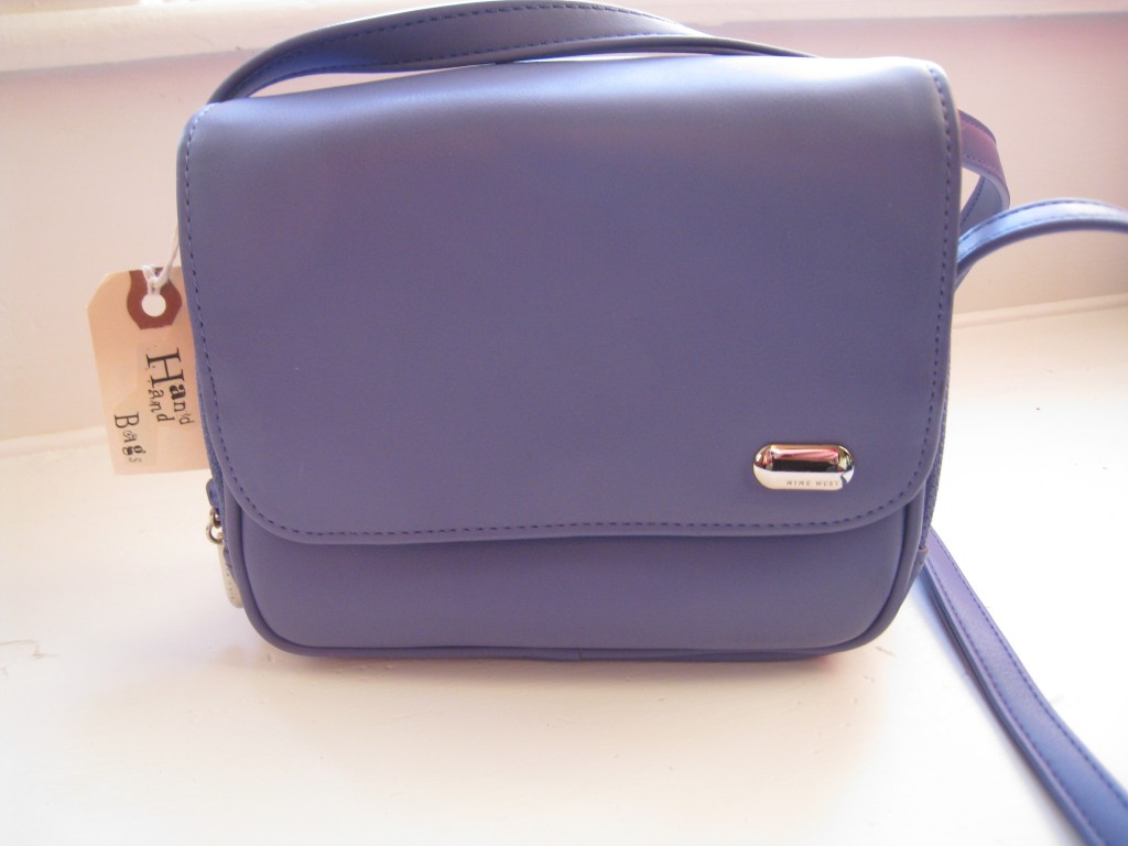 Purple Nine West shoulder bag.  $10.00