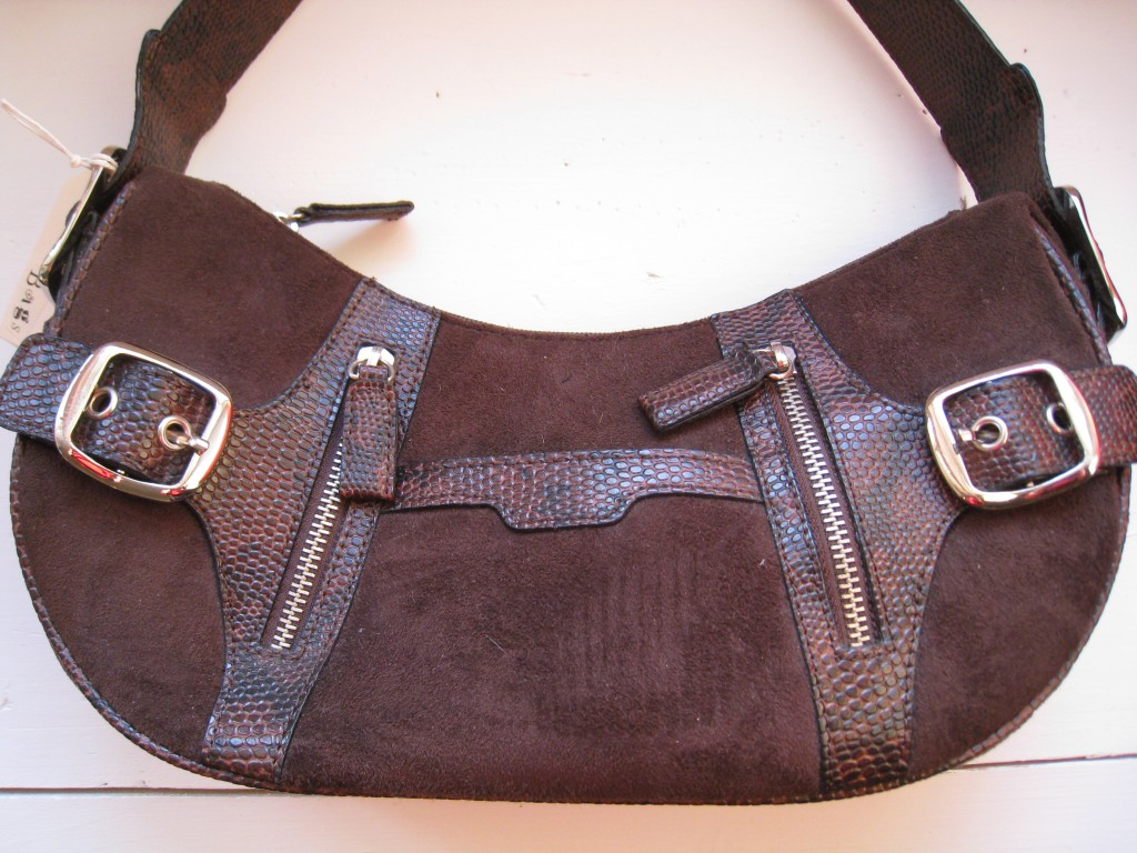 Faux suede with zippers and buckles.  $8.00