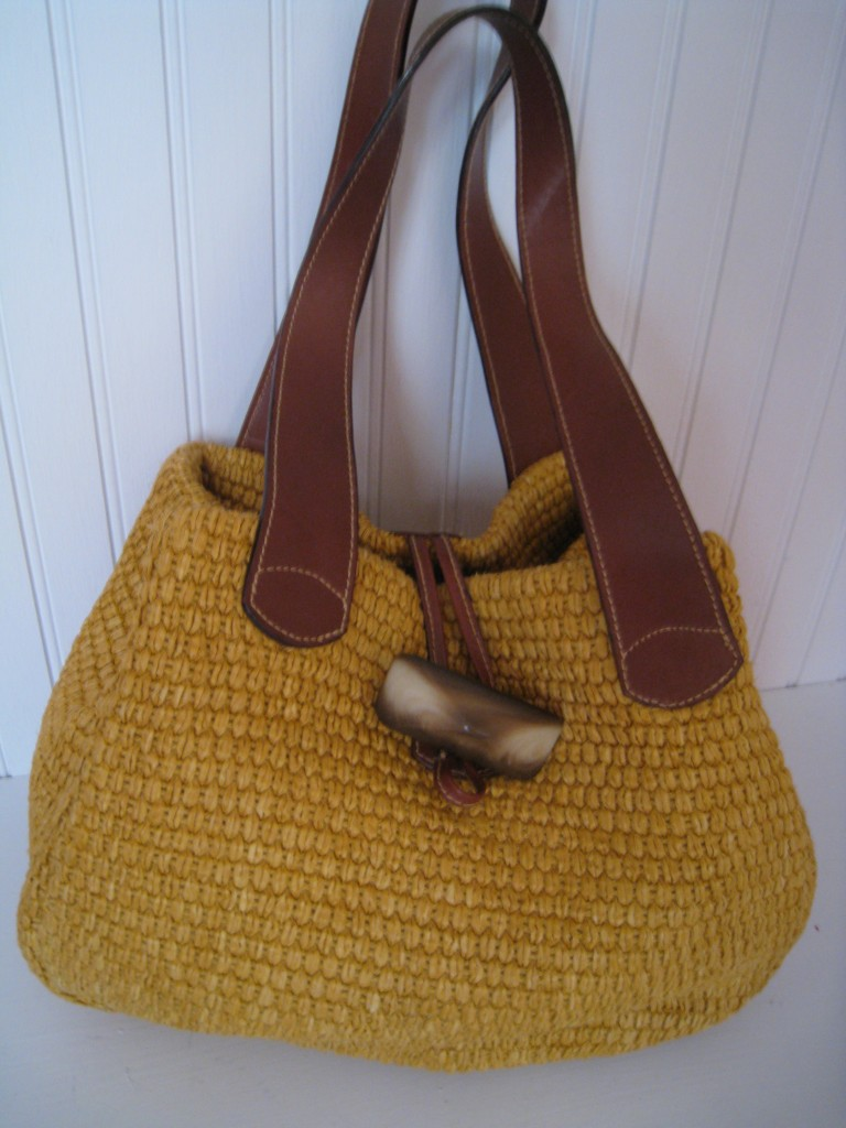 Yellow straw Perswick & Moore.  Leather handles, made in Italy.  $20.00