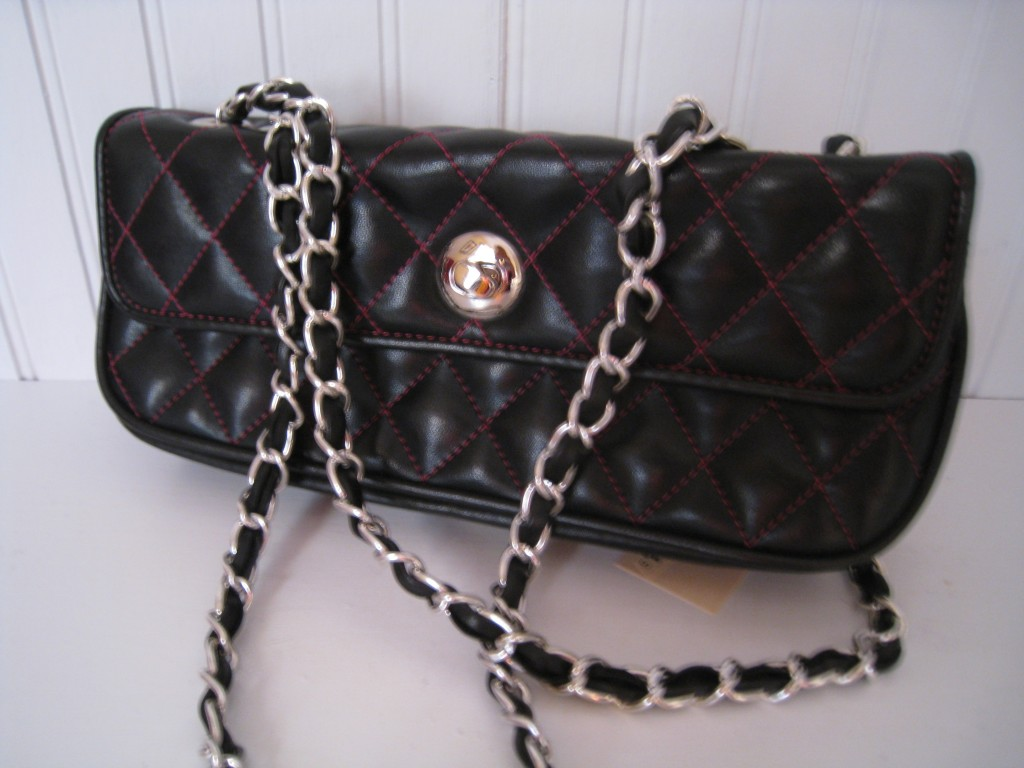 Black quilted Chinese Laundry with chain strap.  Hot pink lining!  $10.00