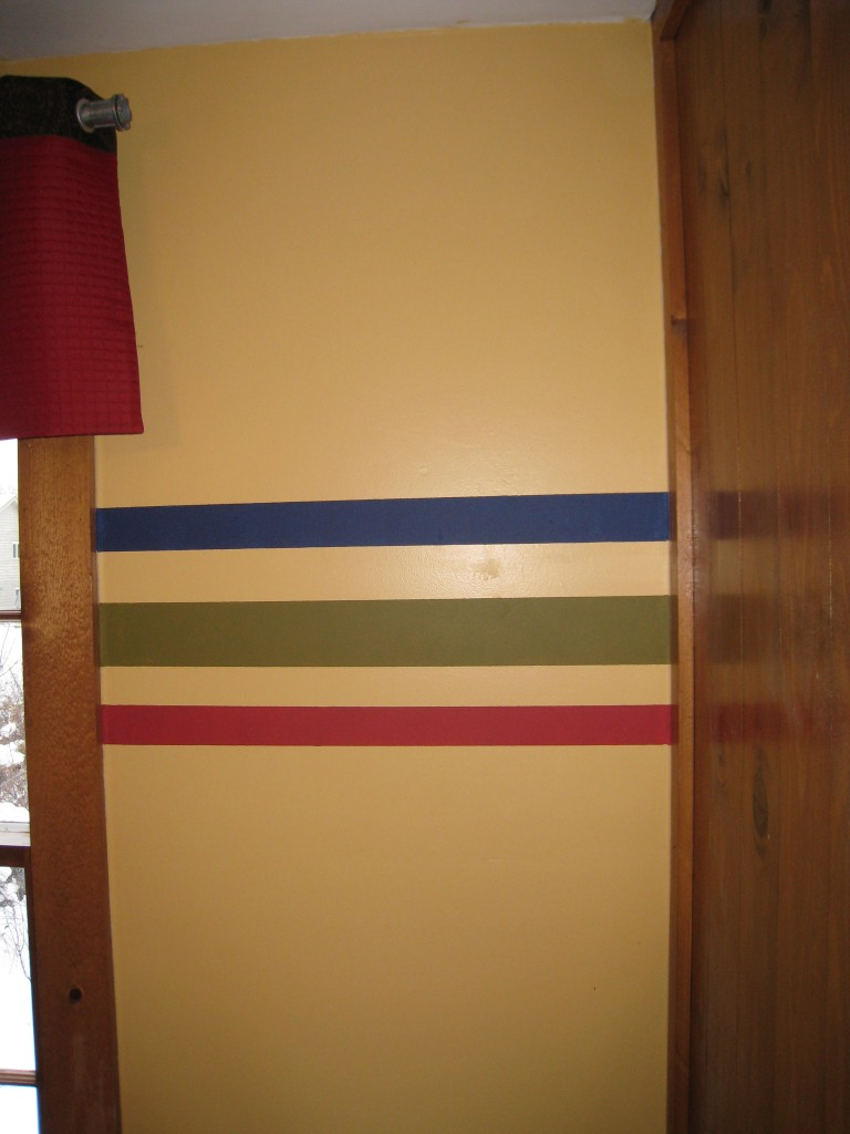 Horizonatal stripes add dimension and color to the room.