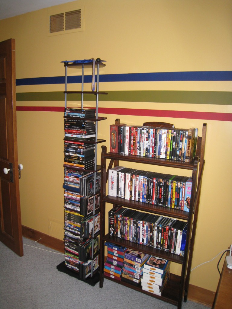 Pat wanted both DVD stands next to each other.  I would have put one behind the chair, but it's his room...