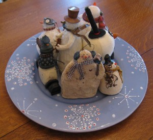 Group your snowman collection on a pretty plate