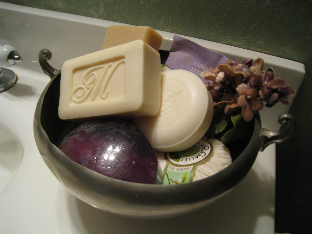 Pile a larger pewter bowl will all kinds of soaps, but be sure to use them!