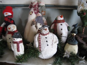 Don't pack the snowmen away just yet, move your collection to the bathroom or guest bedroom