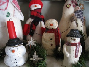 When grouping the snow people together, vary heights, sizes and texture for a more interesting display.