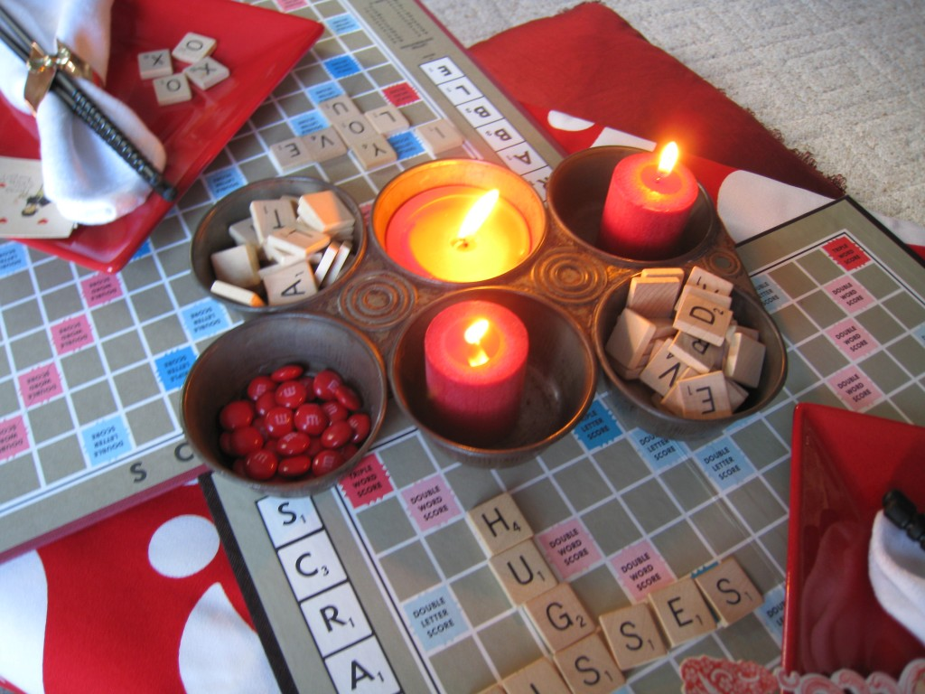 You know you will want extra Scabble pieces with this dinner.  Use a vintage muffin tin for candles and letters