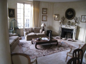 The living room was a combination of comfy sofas and wonderful antiques and art