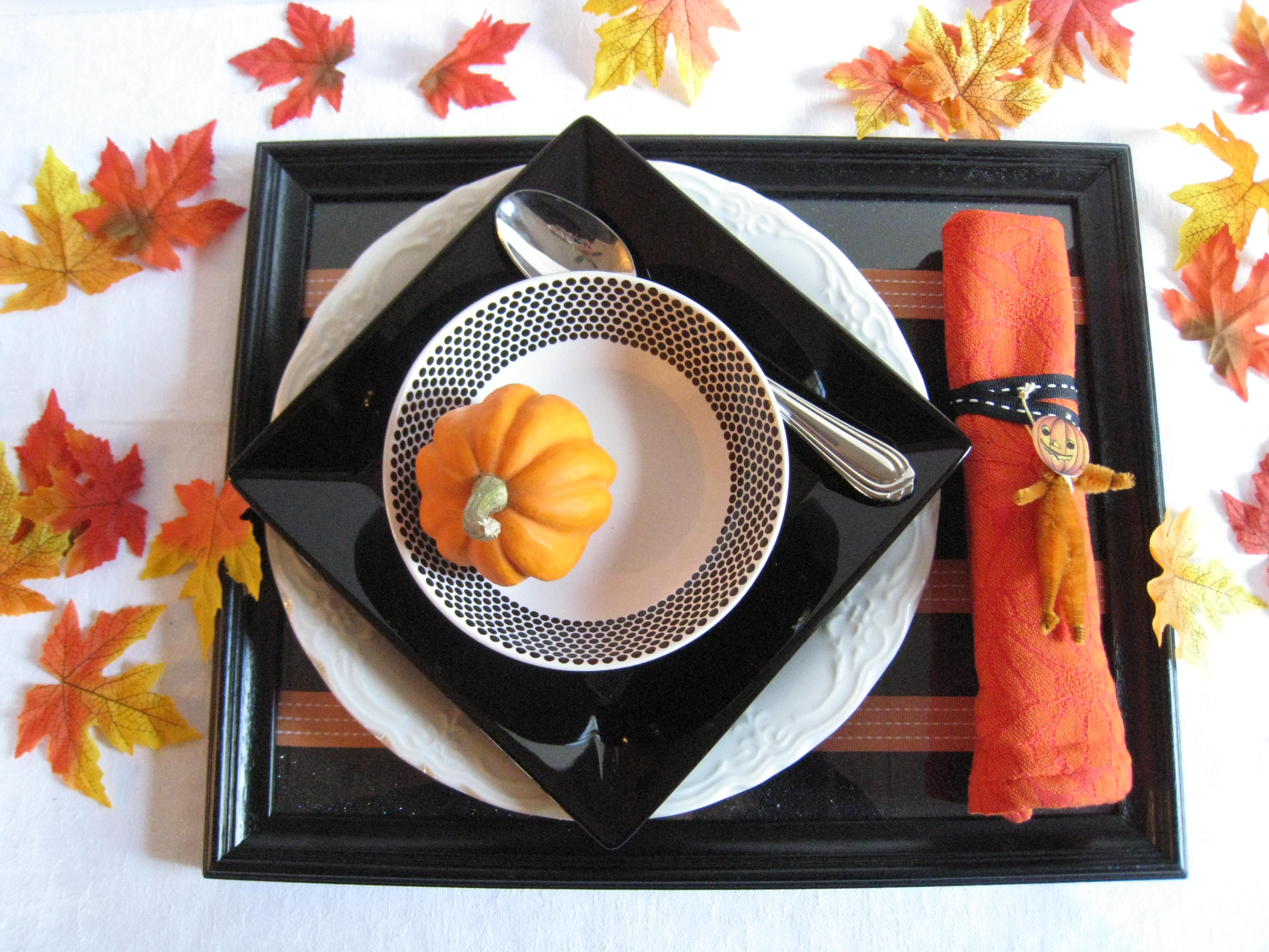 What's black and white and orange all over?  Get in the holiday spirit by setting a festive table.