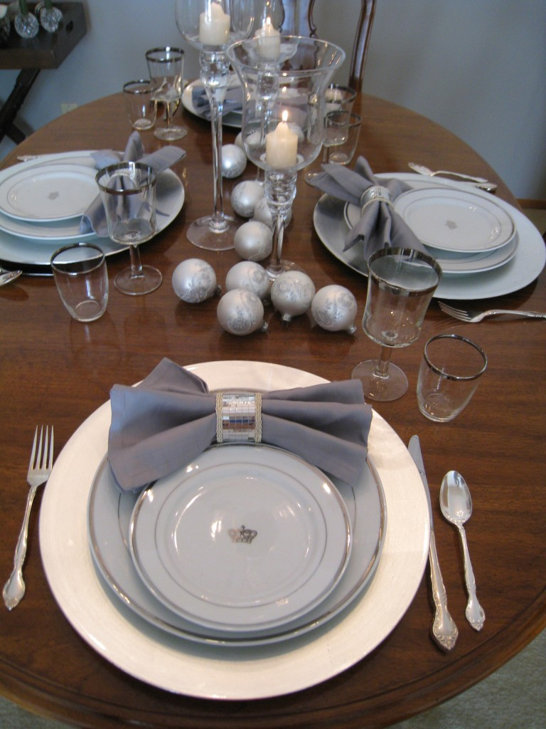 I found the plates, glasses napkin rings, candle holders and ornaments at Goodwill.  You really can set a beautiful table on a budget!