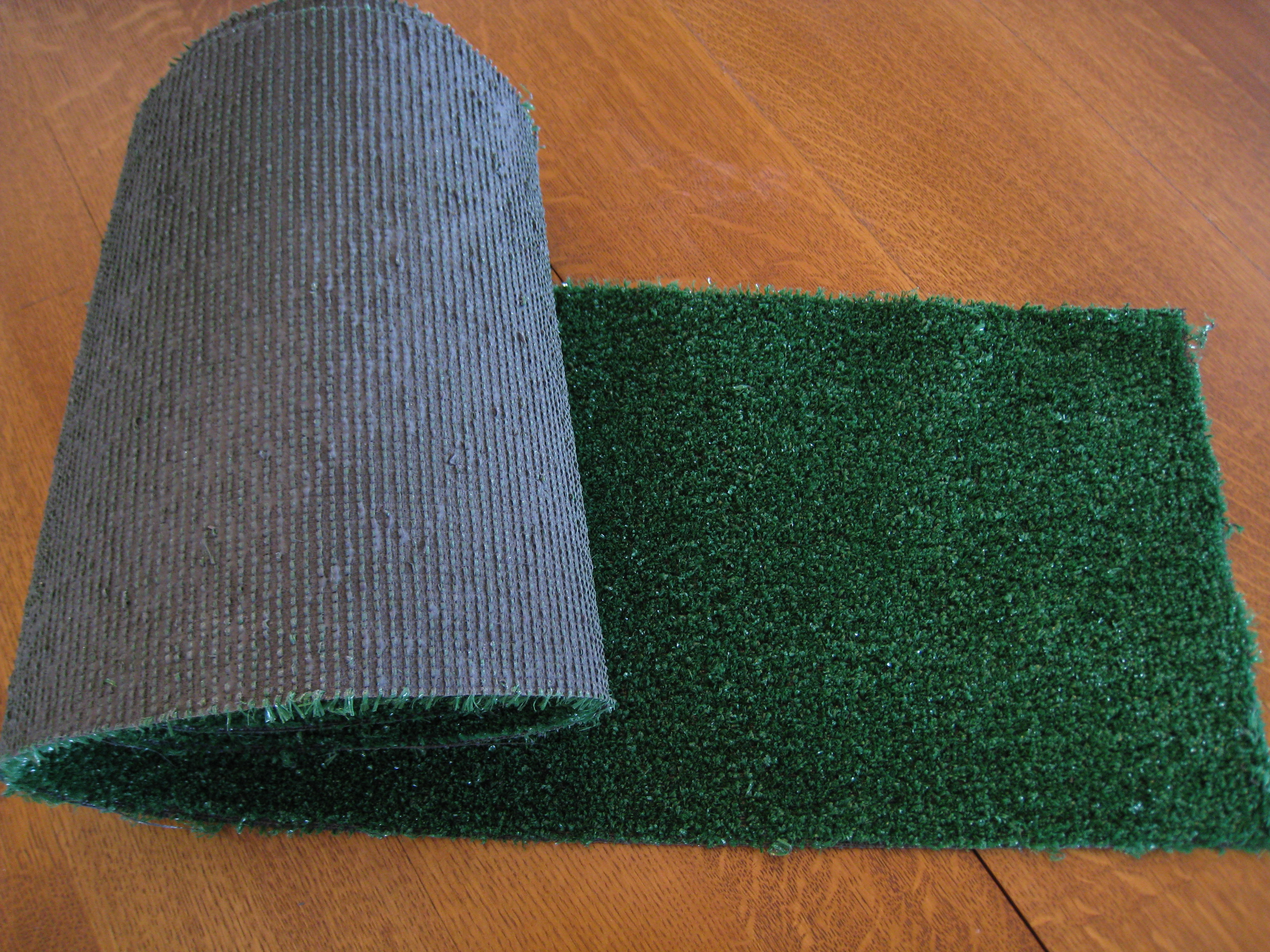 YOu can get pieces of fake grass at any home suppy store