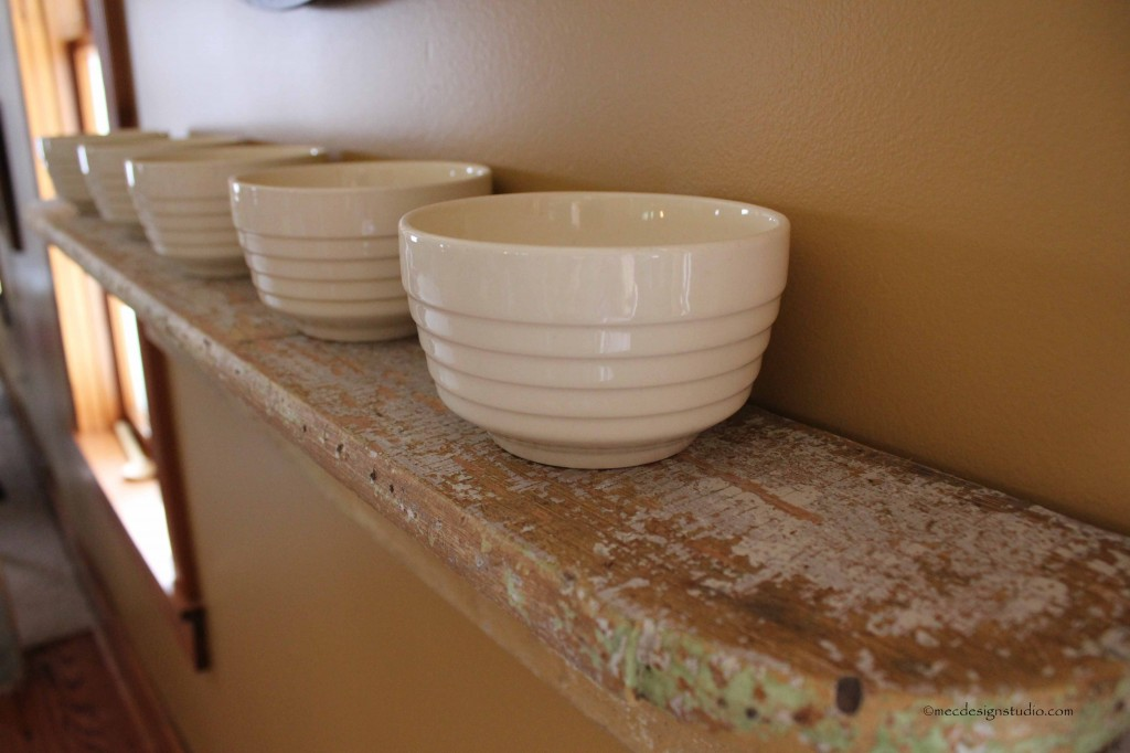 Vintage cereal bowls on old shelf