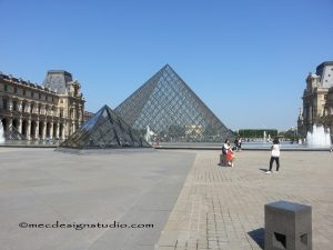 The pyramid entrance to the Louvre